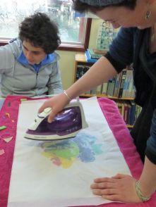 Leila & Maya melting plastic pieces together